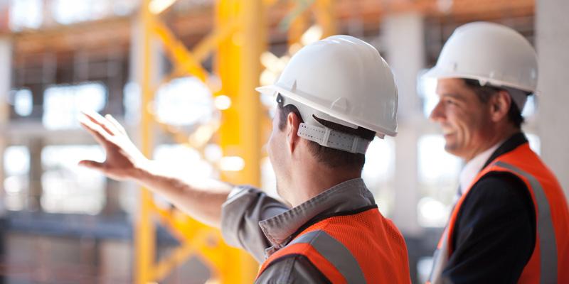 Contractors viewing construction scene