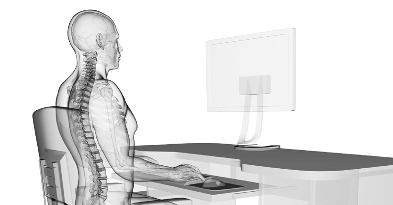 x-ray image of person sitting at desk