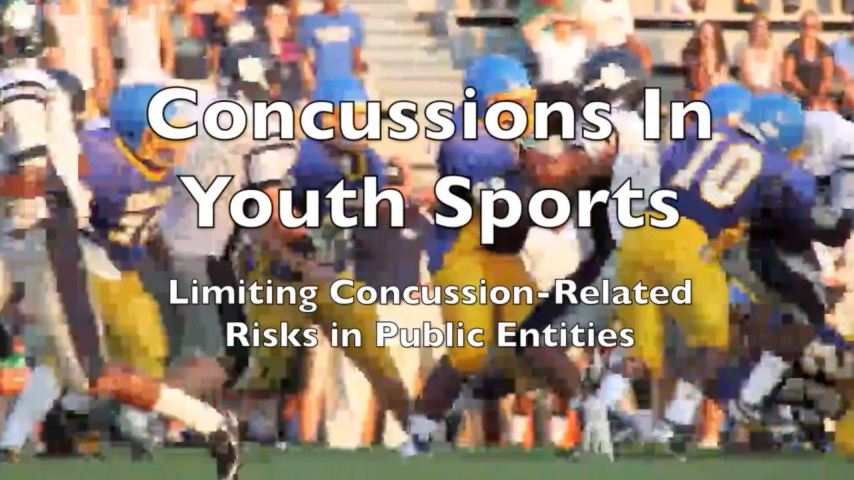 Concussion In Youth Sports video title screen with football game in the backgroud