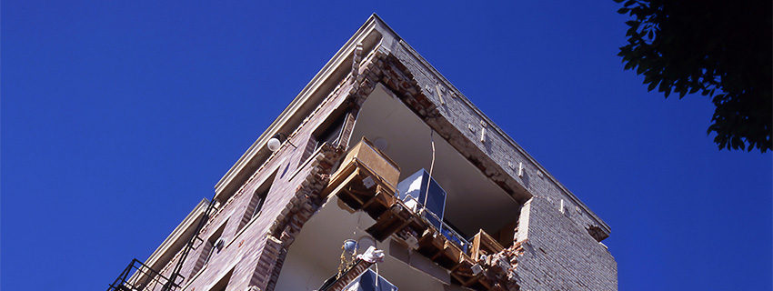Looking up at the corner of a damaged building