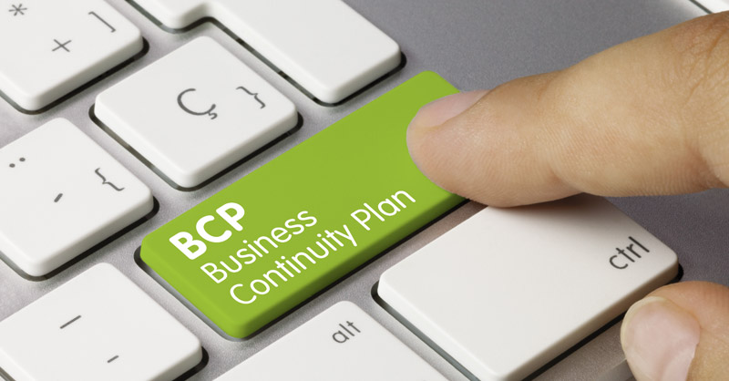 Female finger on Business Continuity Plan (BCP) keyboard