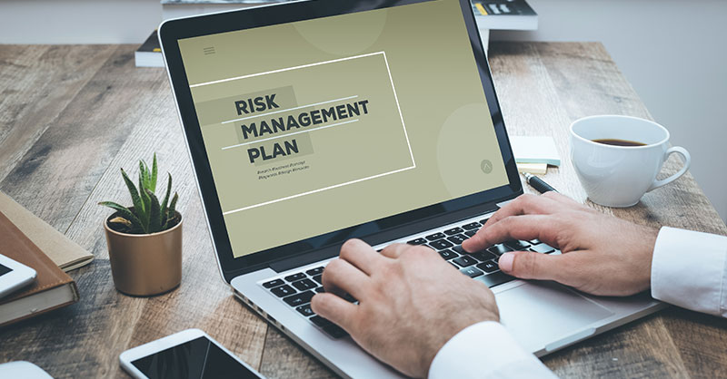 Laptop with the words Risk Management on the screen