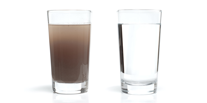 Two glasses of water, one with dirty water and the other with clean water