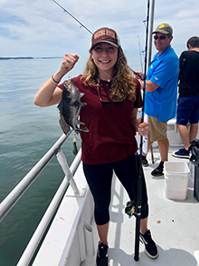 Jenna Prettitore with fish during fishing charter event