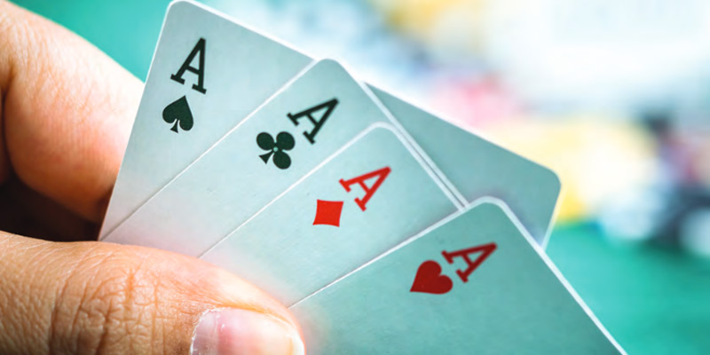 a hand of poker playing cards