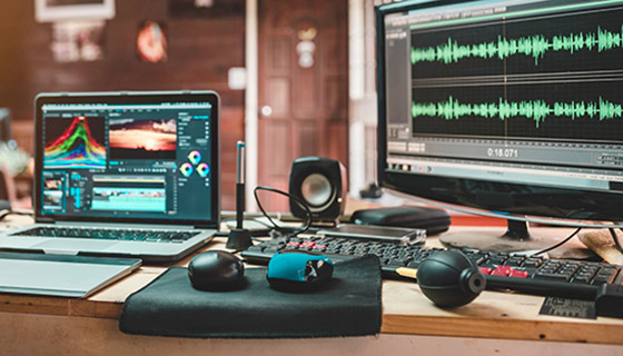 Audio video editing technology including laptop, monitor display, and speakers