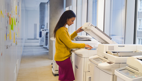 Woman using copier at work